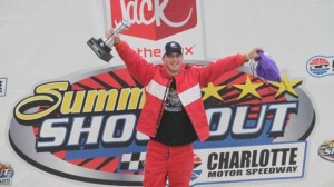 Time Warner Cable News meteorologist Matthew East celebrates his Jack in the Box Summer Shootout Series Media Mayhem school bus race win. (CMS/Jonathan Coleman photo)