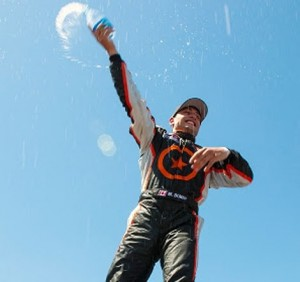 Michael DiMeo celebrates his victory in Sunday's Pirelli World Challenge Touring Car event at New Jersey Motorsports Park. (Pirelli World Challenge Photo)