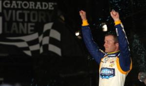 Kasey Kahne celebrates after winning Friday's NASCAR Nationwide Series race at Daytona Int'l Speedway. (HHP/Christa L. Thomas Photo)