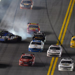 Brendan Gaughan (62) spins in the middle of the field late in Friday's NASCAR Nationwide Series race at Daytona Int'l Speedway. (HHP/David Tulis Photo)
