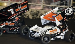 Ian Madsen (18) races under Craig Dollansky Sunday night at Huset's Speedway. (Doug Johnson photo)