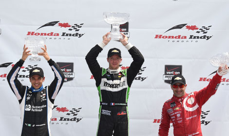 Sebastien Bourdais (center), Helio Castroneves (left) and Tony Kanaan were the top three finishers in the first Verizon IndyCar Series race Sunday in Toronto. (Al Steinberg Photo)