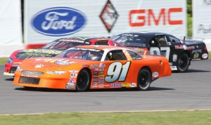 Patrick Laperle (91) goes three-wide during Sunday's ACT International 300 at Airborne Speedway in New York. (Leif Tillotson Photo)
