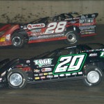 Jimmy Owens (20) races under Eddie Carrier Jr. during Friday's Lucas Oil Late Model Dirt Series race at Tri-City Speedway in Illinois. (Don Figler Photo)