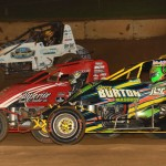 Jeff Bland (04), Chase Stockon (32) and Hunter Schuerenberg battle during AMSOIL USAC National Sprint Car Series action Thursday at Lincoln Park Speedway. (Dave Heithaus Photo)