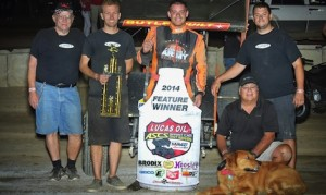 Brad Loyet and crew enjoy victory lane at Black Hills Speedway. (ASCS photo)