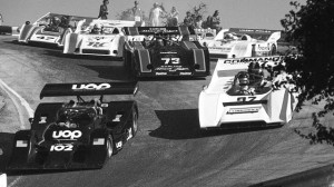 Can-Am rush hour in 1973. Vic Elford in the UOP Shadow (102) leads as Bobby Brown in a McLaren M8F (97), David Hobbs in the McLaren M20 (73), Charlie Kemp in a Porsche 917-10 (23), Ed Felter in a McLaren M8E (47) and Jody Scheckter in a Porsche 917-10 (0) give chase. Elford's Shadow pumped out a rumored 1200 to 1500 horsepower.  Many of these same cars will compete again in the Rolex Monterey Motorsports Reunion. (Mazda Raceway Laguna Seca photo)