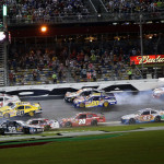 Cars spin in the infield during a late-race crash as part of Friday's NASCAR Nationwide Series race at Daytona Int'l Speedway. (NASCAR Photo)