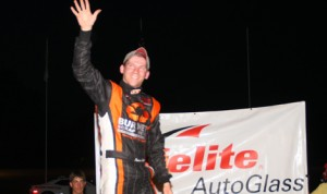 Jason Corliss acknowledges the crowd following his late model victory Thursday at Thunder Road Int'l Speedbowl. (Alan Ward Photo)