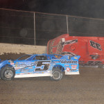 Rickey Frankel (33f) climbs the wall after contact with Brandon Sheppard (b5) during Saturday's DIRTcar Summer Nationals feature at Federated Auto Parts Raceway at I-55. (Don Figler Photo)
