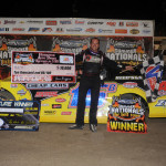 Brian Birkhofer stands in victory lane after winning Saturday's DIRTcar Summer Nationals feature at Federated Auto Parts Raceway at I-55. (Don Figler Photo)