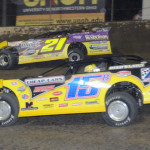 Brian Birkhofer (15b) battles Billy Moyer during Saturday's DIRTcar Summer Nationals feature at Federated Auto Parts Raceway at I-55. (Don Figler Photo)
