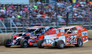 Danny Johnson (27j) races under Justin Haers at New York's Albany-Saratoga Speedway. (Dave Dalesandro photo)