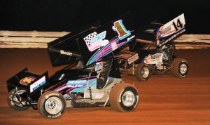Lance Dewease (14) chases Lucas Wolfe en route to winning Saturday's World of Outlaws STP Sprint Car Series race at Wiliams Grove Speedway. (Julia Johnson photo)