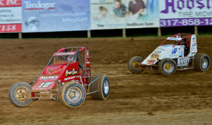Jerry Coons Jr. (10e) leads Shane Cottle during AMSOIL USAC National Sprint Car Series action Friday at Lincoln Park Speedway. (Frederics Photography Photo)
