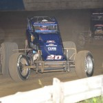 Bryan Clauson (20) leads Dave Darland during Wednesday's AMSOIL USAC National Sprint Car Series event at the Terre Haute Action Track. (Frederics Photography Photo)