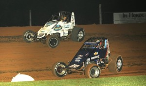 Bryan Clauson (20) charges under Hunter Schuerenburg Friday night at Bloomington Speedway. (Ginny Heithaus photo)
