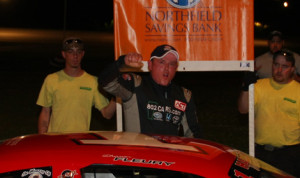 Shawn Fleury climbs from his car after earning his first career Thunder Road Int'l Speedbowl late model win Sunday night. (Alan Ward Photo)