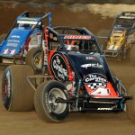 Tracy Hines (4), Chris Windom (11) and Brady Short battle Wednesday during AMSOIL USAC National Sprint Car Series action at the Terre Haute Action Track. (Dave Heithaus Photo)