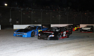 Harrison Burton (12) races with Preston Peltier Thursday night at Greenville Pickens Speedway during PASS South competition. (LWPictures.com Photo)