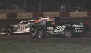 Jimmy Owens (20) races under Scott Bloomquist Tuesday night at Lakeside Speedway. (Ivan Veldhuizen photo)