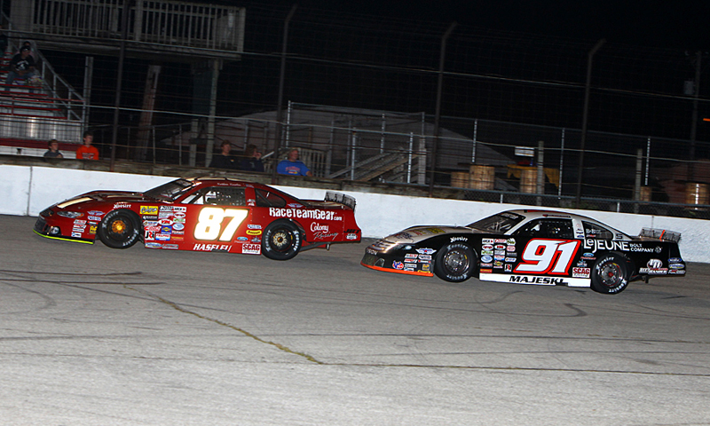 Nathan Haseleu (87) battles Ty Majeski for the lead during Saturday's ARCA Midwest Tour event at Hawkeye Downs Speedway in Iowa. (Mike Ruefer Photo)