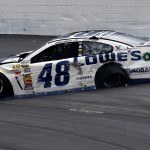 Jimmie Johnson's damaged Chevrolet slides down the track after crashing early in Sunday's NASCAR Sprint Cup Series race at New Hampshire Motor Speedway. (NASCAR Photo)