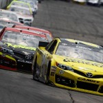 Matt Kenseth (20) leads a pack of cars during Sunday's NASCAR Sprint Cup Series race at New Hampshire Motor Speedway. (NASCAR Photo)