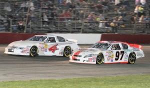 Sergio Pena (4) battles Jesse Little during NASCAR K&N Pro Series East action at Columbus (Ohio) Motor Speedway. (Todd Ridgeway photo)