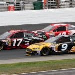 Ricky Stenhouse Jr. (17), Marcos Ambrose (9) and Kyle Larson battle for position during Sunday's NASCAR Sprint Cup Series race at New Hampshire Motor Speedway. (Dick Ayers Photo)