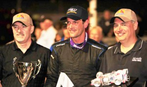 Otto Sitterly, pictured with Novelis representative Chris Smith (left) and Tom Salvador (right), was the winner of the lucrative $10,000 to win Mr. Novelis Supermodified main event at Oswego Speedway in 2013. (Bill Taylor Photo)