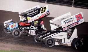 Daryn Pittman (9) battles Kerry Madsen during Saturday night's World of Outlaws feature at Dodge City Raceway Park. (Ken Simon photo)