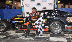 Zach Brewer celebrates in victory lane after his victory in Saturday's KOMA Unwind Modified Madness Tour event at Hickory (N.C.) Motor Speedway. (Pete Anderson Photo)