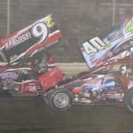 Caleb Griffith (40) and Duane Zablocki battle during sprint-car action at Attica Raceway Park. (Action Photo)