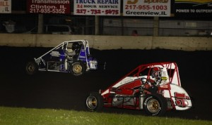 Chett Gehrke fights off Zach Daum (5) Friday night at LIncoln (Ill.) Speedway. (Mark Funderburk photo)