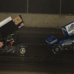 Danny Lasoski (33) leads Rico Abreu during a MOWA Sprint Car Series race at Tri-City Speedway in July. (Mark Funderburk Photo)