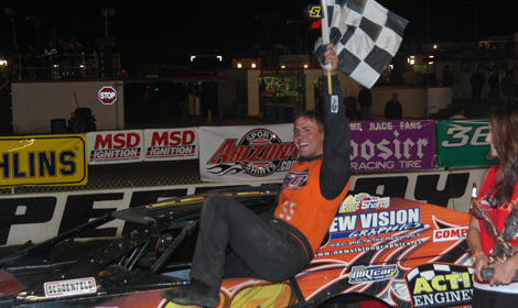 Steve Arpin celebrates a dirt modified victory several years ago. (Dan Fennell Photo)