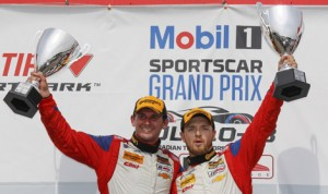 Andy Lally (left) and Matt Bell celebrate after winning the Grand Sport portion of Saturday's Continental Tire SportsCar Challenge race at Canadian Tire Motorsports Park. (Michael Levitt/LAT Photo)