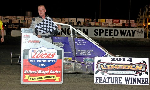 Chett Gehrke stands in victory lane after winning Friday's POWRi Lucas Oil National Midget Series race at Lincoln Speedway. (R.J. Brown Photo)
