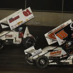 Parker Price-Miller (01) leads Ian Madsen during Thursday's MOWA Sprint Car Series race at Tri-City Speedway. (Mark Funderburk Photo)