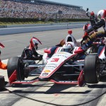 Helio Castroneves makes a pit stop during Sunday's Verizon IndyCar Series race at Pocono Raceway. (Bruce A. Bennett Photo)