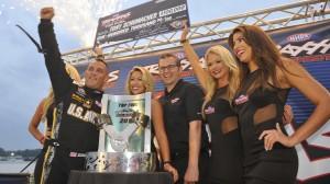 Tony Schumacher celebrates his $100,000 win  in Saturday's Traxxas Shootout. (NHRA photo)