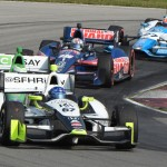 Josef Newgarden (67) leads a group of cars through a corner during Sunday's Verizon IndyCar Series race at the Mid-Ohio Sports Car Course. (Al Steinberg Photo)