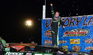 Jimmy Owens celebrates after pocketing $50,050 for winning the USA Nationals at Cedar Lake Speedway. (Bruce Nuttleman Photo)
