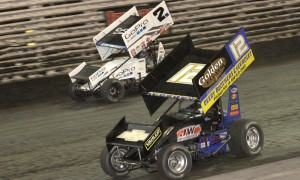 Lynton Jeffrey (12) works his way under Shane Stewart during Sunday's Capitani Classic at Knoxville Raceway. (Dick Ayers Photo)