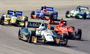 Ed Carpenter (20) leads a pack of cars during the Verizon IndyCar Series event at The Milwaukee Mile. (Dave Heithaus Photo)