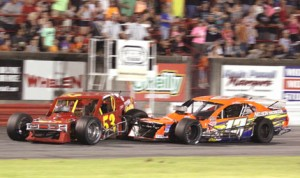 Chris Fleming (13) makes contact with Danny Bohn as they battle for the lead during modified action at Bowman Gray Stadium Saturday night. (Eric Hylton Photo)