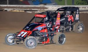 Daryn Pittman (21) battles Christopher Bell during Tuesday's Jason Leffler Memorial race at Wayne County Speedway. (Don Figler Photo)