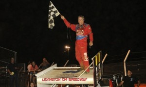 Jeff Swindell celebrates victory at Lexington 104 Speedway. (ASCS /Rob Kocak photo)