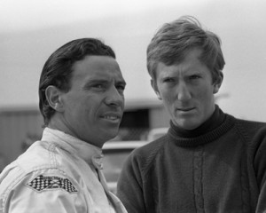 Two-time Formula One Champion Jim Clark (left) and fellow driver Jochem Rindt are seen at North Carolina Motor Speedway prior to the 1967 American 500. (Don Hunter/Smyle Media Photo)